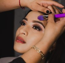 woman-applying-makeup-4006709-scaled